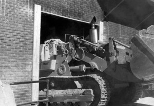 A bulldozer coming out from under the Stevens Center during repair. Courtesy of Scott Spencer.