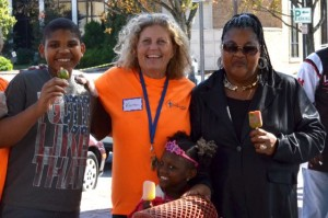 Outreach and Hospitality coordinator of First Presbyterian Church, Karen Schoulda (orange shirt) with Crystal Hall and her two grandchildren, Rahnard and Mila Hall