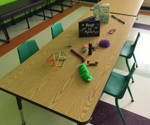 Table with fidget toys and books in the Quiet Room.